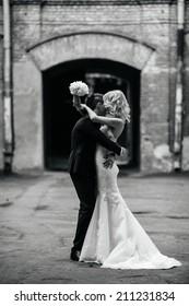 Happy bride and groom walking together
