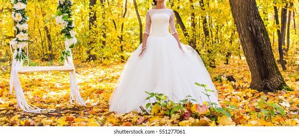 happy bride on autumn forest, wedding day