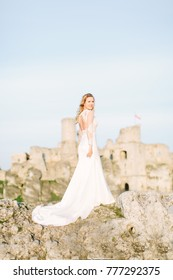 Happy bride on the ruins of the castle Ogrodzieniec