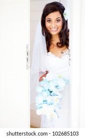 happy bride opening the door