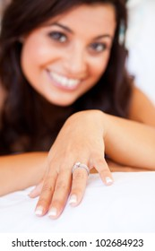 happy bride showing her wedding ring