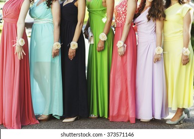Happy bridesmaids in multicolored dresses at wedding ceremony