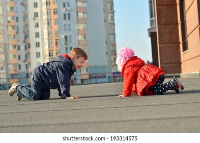 Happy brother and sister having fun in the street