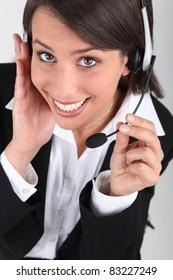 Happy brunette call-center worker