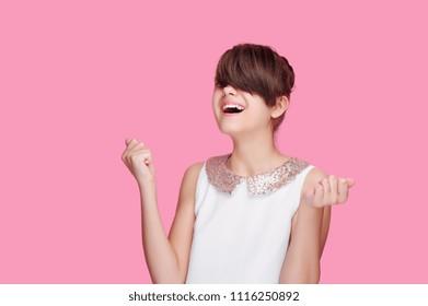Happy brunette girl expressing success feelings