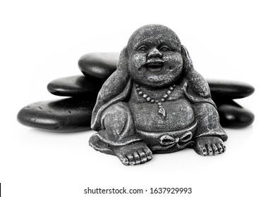 happy buddha statue with massage stone isolated on white