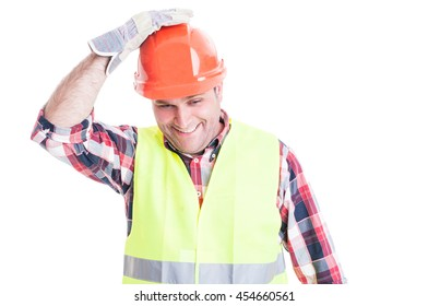 Happy builder holding hand on helmet acting funny isolated on white studio background