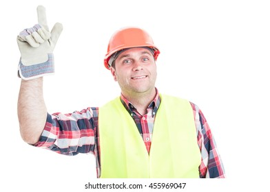 Happy builder pointing finger up and having an idea isolated on white background