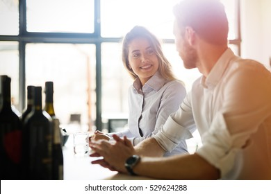 Happy business colleagues dating in restaurant