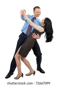 Happy business couple dancing and laughing, against white background