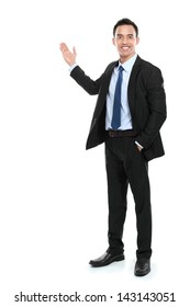 Happy business man giving presentation on copy space. isolated over white background
