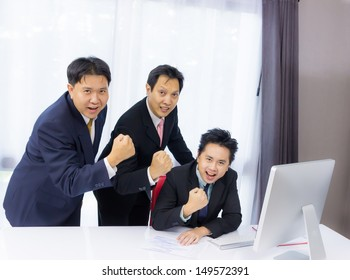 happy business man with hand up for project success