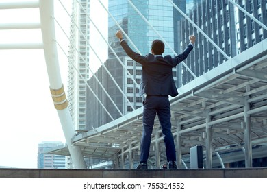 happy business man open arm with office blur background,celebration success together happiness concept