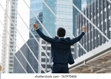 happy business man open arm with office blur background,celebration success happiness concept