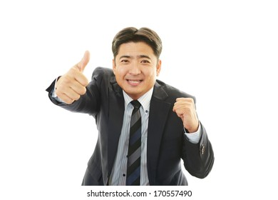 Happy business man showing thumbs up sign