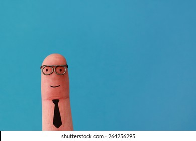Happy business man smiling on blue background - funny finger people