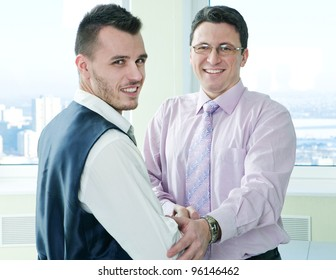happy business mans have a lucky meet with colleague in office room