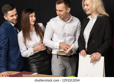 Happy business partners. Group of young modern people in smart casual wear. Friendly bisiness team have work in the office using laptop on table