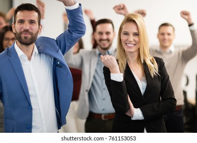 Happy business people celebrating success