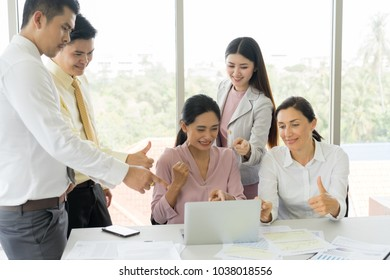 Happy business people cheering and showing thumb up at office. Happy time in the office.