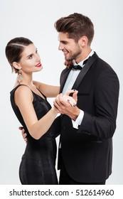 Happy business people dancing. eyes to eyes