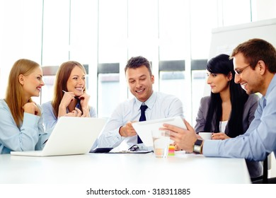 Happy business people during corporate meeting