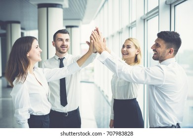 The happy business people greeting