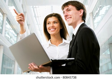 Happy business people in an modern office building