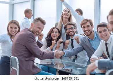 happy business people shaking hands in the conference room