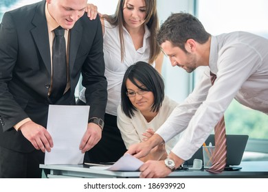 Happy business people teamworking in office environment