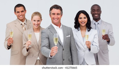 Happy business team celebrating a success with champagne
