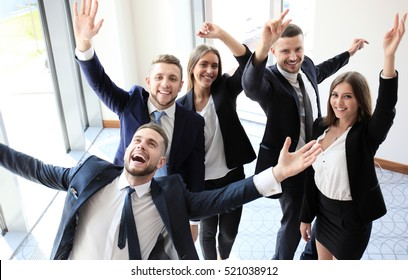 happy business team celebrating victory in office