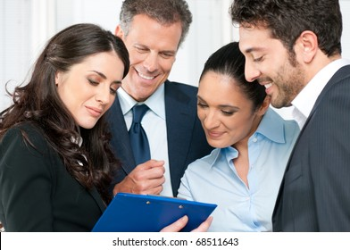 Happy business team discussing together their business strategy at office