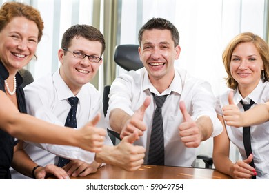 Happy business team expressing positivity and success during meeting in board room in the office. Happy people know how to work with serious business projects.