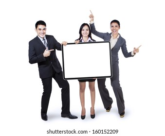Happy business team holding empty billboard isolated on white background