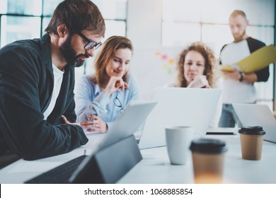 Happy business team making conversation at sunny meeting room.Horizontal.Blurred background
