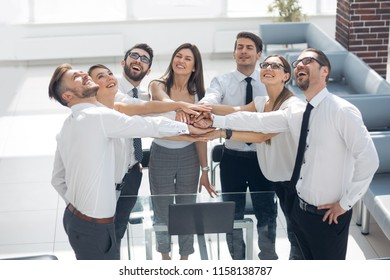 happy business team showing their unity and looking up