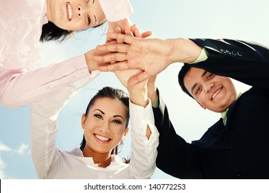 Happy business team showing unity