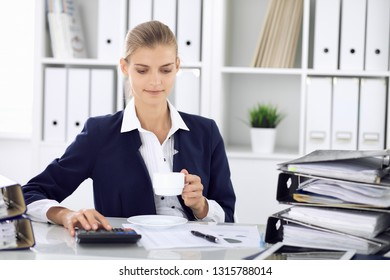 Happy business woman or female accountant having some minutes for  time off and pleasure at working place. Audit and tax concepts in business