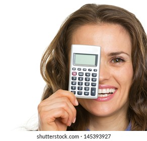 Happy business woman holding calculator in front of face