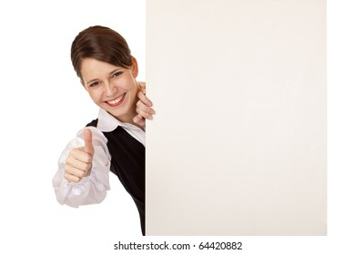 happy business woman holds blank billboard and shows thumb. Isolated on white background.