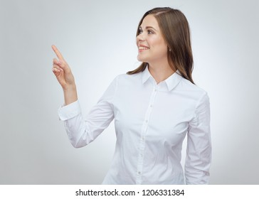 Happy business woman pointing with finger at copy space. Isolated portrait on white.