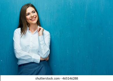 Happy business woman portrait. Young woman white shirt dressed.