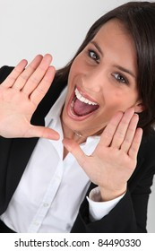 Happy business woman shouting