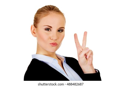 Happy business woman showing victory sign