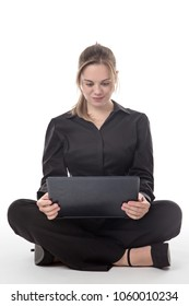 happy business woman sitting on the floor using a laptop computer