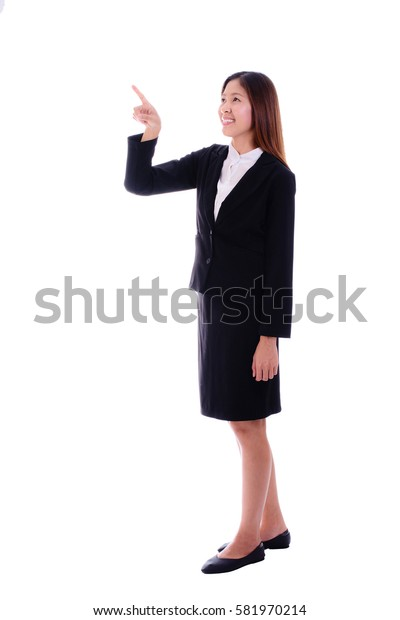 Happy  business woman smiling and pointing in the air on white background.