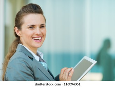 Happy business woman using in tablet PC