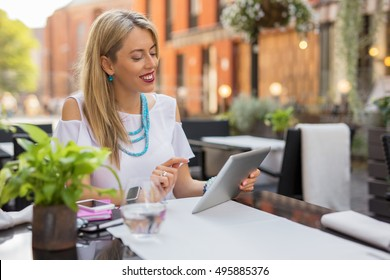 Happy business woman using tablet