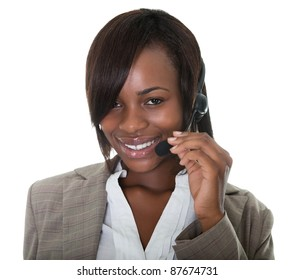 Happy business woman wearing a headset on white background.